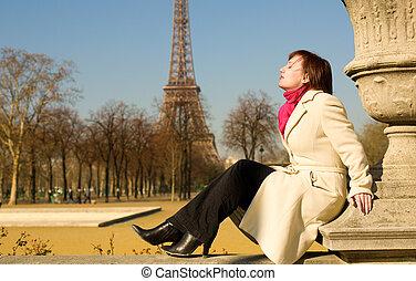 Beautiful woman in Paris enjoying warm spring day