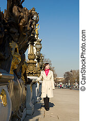 Beautiful woman in Paris on the Pont Alexandre III