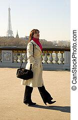 Beautiful woman in Paris walking on the Pont Alexandre III