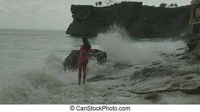 Beautiful woman in pink bikini at the beach