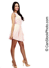 Beautiful woman in pink dress on white background