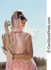 Beautiful woman in pink scarf