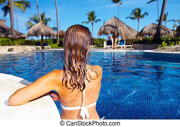 Beautiful woman in pool - Beautiful woman in swimming pool....