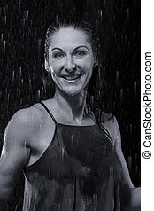 Beautiful woman in rain at night getting wet artistic conversion