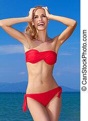 Beautiful woman in red bikini - Beautiful , smiling woman in...