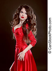 Beautiful Woman in red dress. Attractive fashion girl model ...