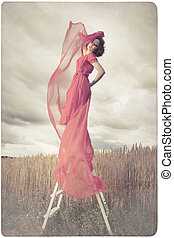Beautiful woman in red dress back