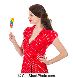 Beautiful woman in red dress with colorful lollipop