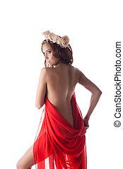 Beautiful woman in red fabric