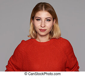 Beautiful woman in red sweater smiling. Isolated