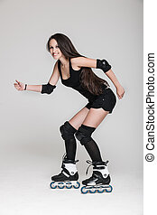 Beautiful woman in roller skates