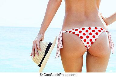 Beautiful woman in sexy bikini at the beach