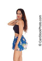Beautiful woman in short skirt standing