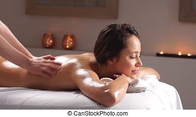 Beautiful woman in spa salon.
