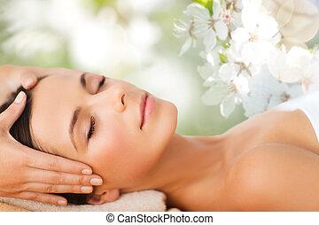 beautiful woman in spa salon having facial massage