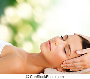 beautiful woman in spa salon having facial - spa, resort,...