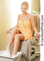 woman in spa salon having pedicure