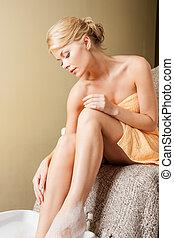 woman in spa salon having pedicure