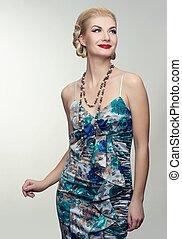 Beautiful woman in summer dress.