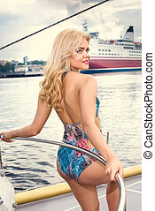 beautiful woman in swimsuit  on yacht