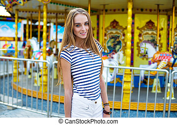 Beautiful woman in the amusement park