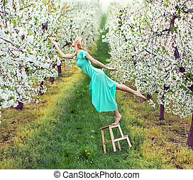 Beautiful woman in the colorful orchard