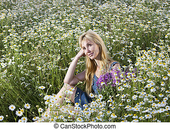 beautiful woman in the field of camomiles