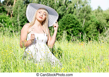Beautiful woman in the grass