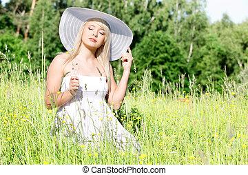 Beautiful woman in the grass