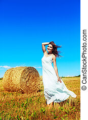 woman in the harvested wheat field - beautiful woman in the...