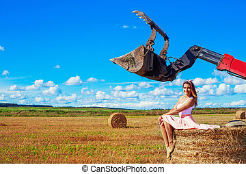 beautiful woman in the harvested  wheat field