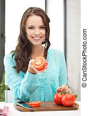 woman in the kitchen cutting vegetables