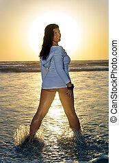 Beautiful Woman in the Ocean at Sunrise (1)