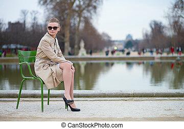 Beautiful woman in the Tuileries park