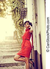 Beautiful woman in urban background