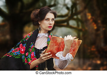 beautiful woman in vintage dress walking in autumn park.