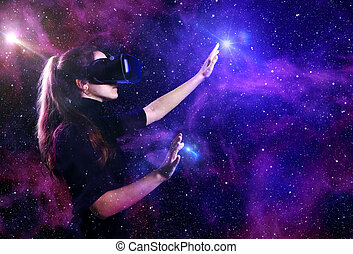 Beautiful woman in virtual reality glasses on a futuristic background.