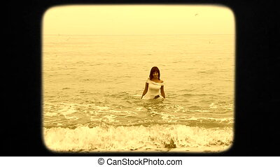 Beautiful Woman In White Dress Comes Out Of The Black Sea
