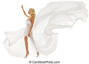 Beautiful woman in white dress with flying fabric walking...