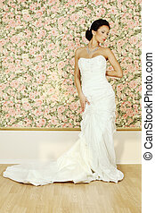 Beautiful woman in white evening gown, fashion portrait