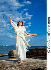 beautiful woman  in white on seacoast