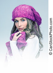 beautiful woman in winter hat - blue-toned picture of...