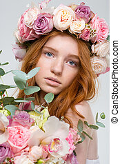 Beautiful woman in wreath of roses with flowers bouquet - ...