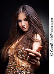 beautiful woman inviting - beautiful woman in golden dress...