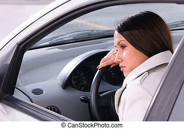 woman is resting in a car