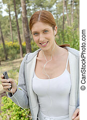 Beautiful woman jogging in forest