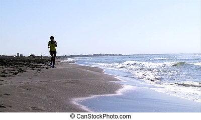 Beautiful woman jogging on beach