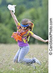beautiful woman jump on field