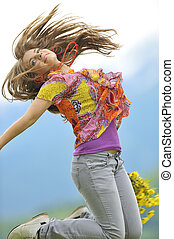 beautiful woman jump on field