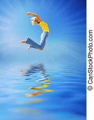 Beautiful woman jumping over the water